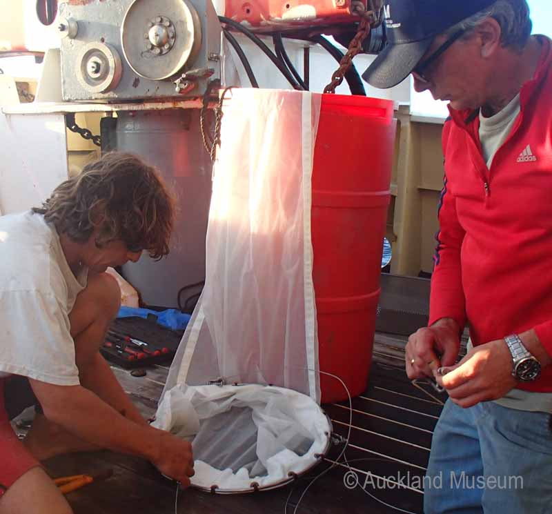 Crew member Steve and Tom rigging up a plankton net